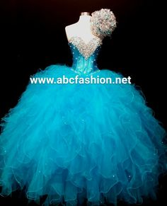 Pretty turquoise quinceanera dress with matching bouquet www.abcfashion.net…