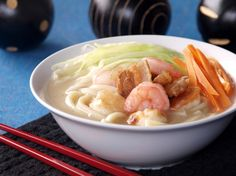 Filipino lomi: Egg noodles served in thick starchy gravy with crispy pork pieces, shrimps and vegetables.
