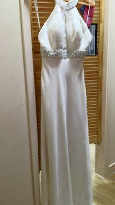 Size 10 Halterneck Wedding Dress at Mind Charity Shop in Harrow.