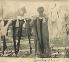 Laundry day, July 1920 Love it... laundry in the front yard & she's happily pinning it in what looks like her housecoat!  Geez, in some of the subdivisions near to where I live, you're not even allowed to have a clothesline in your own backyard!