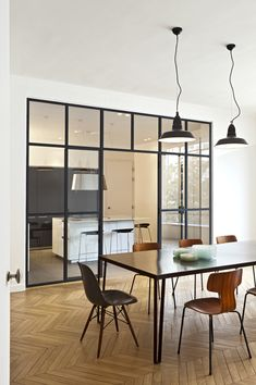 I just love the window wall between the dining room and the kitchen.. I love the glass look!!