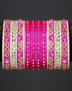 $8.00  Save: 50% off  Dazzling Indian designer bangles set with two dozen bangles in pink and golden color for all those who love the combination of Indian craftsmanship and style. You can either wear this complete set or some bangles at different occasions. Wear the glittering and dazzling fashion accessories with any wedding outfit!