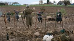 Actors from various living history groups are dressed in World War I British and German uniforms as they re-enact the 1914 Christmas Truce in Ploegsteert, Belgium.