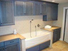 Neat idea - blue painted craftsman cupboards, tub like a farmer's sink