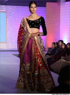 Bridal wear design by Ritu Kumar in dark hues of black and red. A touch of gold embellishment for all the glamour that Indian bridal wear demands. Indian Bridal Lehenga, Indian Bridal Outfits, Indian Bridal Wear, Indian Dresses, Red Lehenga, Indian Clothes, Indian Wear, Bridal Party Shirts, Bridal Wedding Dresses