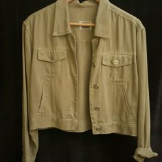 Casual light olive green Jacket Light olive green with metal buttons.  Short jacket, 100% Tencell (very soft fabric hangs very nicely). AKS Jackets & Coats