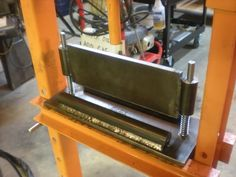 Homemade press brake attachment for a shop press constructed from angle iron, channel, and pipe. Powered by a pneumatic/hydraulic ram. Metal Bending Tools, Metal Working Tools, Welding Gear, Welding Projects, Cool Tools, Diy Tools, Shop Press, Metal Bender, Press Brake