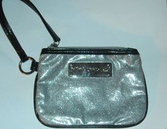 'Betsey Johnson Glittery Silver Wristlet' is going up for auction at  6pm Sun, May 12 with a starting bid of $5.