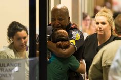 A Dallas Area Rapid Transit police officer receives comfort at the Baylor University Hospital emergency room entrance Thursday, July 7, 2016, in Dallas. Police say one rapid-transit officer has been killed and three injured when gunfire erupted during a protest in downtown Dallas over recent fatal shootings by police in Louisiana and Minnesota. (Ting Shen/The Dallas Morning News via AP)Dallas War Zone: 11 COPS SHOT, 5 DEAD in coordinated ATTACK after Obama's Incitement Speech | Pamela Geller