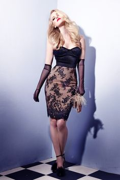 Black Lace elegant highwaisted pencil skirt artfully constructed with a lingerie-inspired aesthetic.
