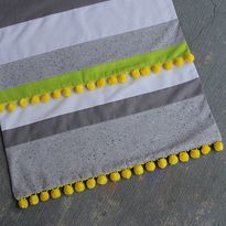 Fiesta Table Runner with Pom Poms - Start with striped fabric (go through upcycled bin!) - Add Pom Poms or Ric Rac and Done!