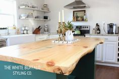 DIY Kitchen Island by The White Buffalo - love the old wood island!