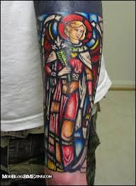 What does stained glass tattoo mean? We have stained glass tattoo ideas, designs, symbolism and we explain the meaning behind the tattoo. Time Tattoos, Arm Tattoos For Guys, Body Art Tattoos, Color Tattoos, Catholic Tattoos, Religious Tattoos, Religious Tattoo Sleeves, Stained Glass Tattoo, Thigh Piece