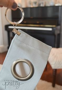 Sewing Curtain grommet curtain hack step two - A super easy, no-sew curtain hack to transform basic grommet curtains into more stylish and polished pleated drapes with crisp folds.