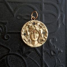Hey, I found this really awesome Etsy listing at https://www.etsy.com/listing/172475054/antique-art-nouveau-locket-lady-with