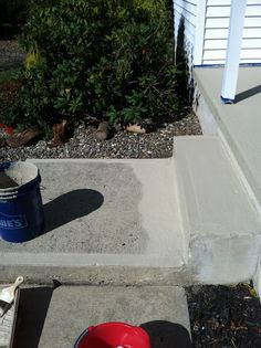 Resurfacing Concrete: Porch Makeover. - fills in imperfections and gives cracked cement and new and even look. Might need for the porch! $25 a can from lowes