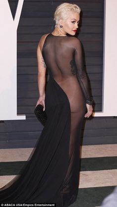 Rita Ora showed a lot of skin, an inch of bum cheek and a selection of tattoos thanks to her extreme cut-away, booty-baring gown on the red carpet for the Vanity Fair Oscar Party 2015.