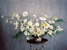 white arrangement of dogwood, pear blossom, fern, hellebore, Iceland poppy, lilac, sweet pea and fringed tulip by Sarah Winward
