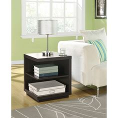 Add storage space to your living room or den with this espresso wooden end table. Keep your favorite books handy or display decorative items. The contemporary design gives it a unique look, and it can be used on either end of your sofa.