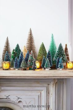 Make your mantel look amazing with a colorful assortment of vintage and inexpensive evergreens. The bottle‐brush variety are readily available online and at crafts stores; the miniature ones were plucked from a model train set. #christmas #holidayideas #christmasideas #wintertodo #marthastewart