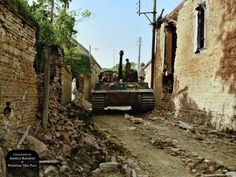 One of the three Stabskompanie Panzer VI Tigers of s.SS-Pz.Abt.102 moves through a small French village in Normandy, July 1944. #TigerTank #Normandy