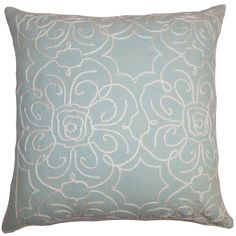 Brighten up your living room or bedroom with this exquisite floral throw pillow. This square pillow features an intricate floral pattern stitched on a blue fabric.