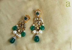 Beautiful kundan earing with green polki and pure white pearls.