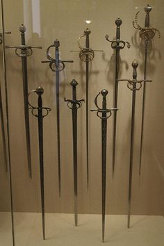 Metropolitan Museum: Rapiers Front row, left-to-right: -Rapier of Emperor Charles V: Italy (Milan), ~1540. -Rapier: Italy, 1550-60. -Rapier: Italy (possibly Brescia), ~1550. -Rapier: Europe, ~1570-80. Back row, left-to-right: -Rapier: Northern Europe (possibly Germany), 1610-20. -Rapier: Italy, 1620-30. -Rapier: Dutch or Flemish, 1630-40. -Rapier: Northern Europe (possibly Flanders), 1620-30. Sword blades are probably from Toledo, Spain, or Solingen, Germany.
