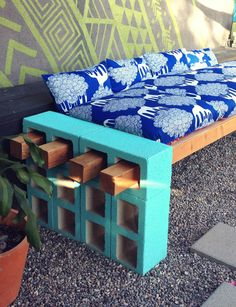 cinderblock and wood outdoor seating. i love that fabric and wall too!
