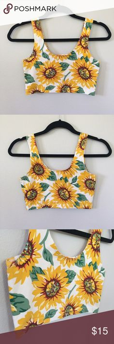 NWOT American Apparel Sunflower Crop Top NWOT. Cute crop top from American Apparel. The length is a little bit longer than a sports bra. Made of 95% cotton and 5% Elastane so it has a bit of a stretch to it. Never worn before!! Such a perfect summer top!  American Apparel Tops Crop Tops