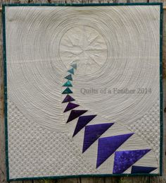 """Loving this stunning quilt by Renee from Quilts of a Feather for a mini quilt swap with a friend. """"I used Aurifil #2605 for most of the quilting. For the compass and around the geese I used #2600. I used #2024 for around the compass. My sewing machine (a Janome Sewing Machines 6300) big-puffy heart loves Aurifil!"""" To see more please visit http://www.quiltsofafeather.com/2014/10/flying-north-mini-quilt.html"""