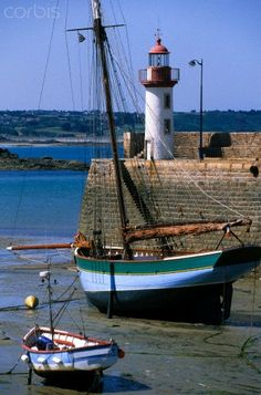 France, Cotes d'Armor, Erquy, rigging and old lighthouse on port