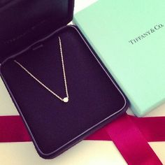 simple classic. tiny diamond with a thin gold chain.