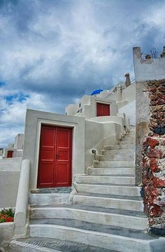 These doors are all over Oia, Santorini. They look like they're going nowhere but behind the doors are steps descending to the home.