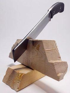 Knife cutting through wood