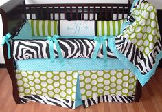 Wild Baby Bedding  This custom crib bedding set includes the bumper, blanket and tailored box pleat crib skirt. The green apple stripe and polka dots print, aqua and white ultra soft minky, and black and white zebra print make this set gorgeous and gender neutral.