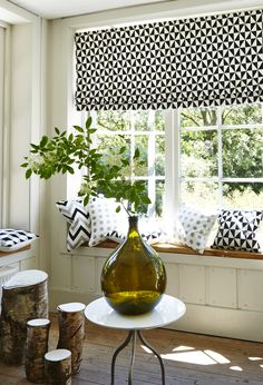 The crisp combination of the black and white geometric print adds a fresh and clean note to this interior.
