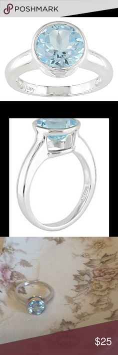 Blue Topaz Ring, Size 8 Blue topaz ring in very good condition. The stone has a nice shine to it and is set in a unique almost floating style. Minimal signs of wear. Size 8 Description below taken from website:                 The perfect everyday accessory, this attractive sterling silver ring showcases a stunning, icy blue topaz center Band made of sterling silver 1 round bezel-set Swiss blue topaz (9 mm) 3.7 carat gem weight Jewelry Rings