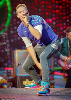 Star performer: Chris Martin, 39, put on a colourful display as he performed at Manchester City's Etihad Stadium for a Coldplay gig on Saturday
