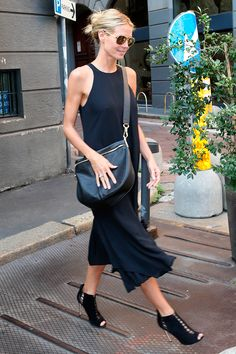 Sleeveless LBD with a crossbody bag and pulled back hair.