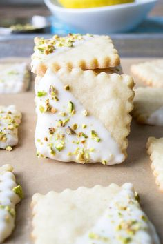 Crisp lemon shortbread cookies dipped in white chocolate and topped with pistachios. A pretty spring cookie bursting with flavor. Lemon Shortbread Cookies, Pistachio Cookies, Shortbread Recipes, Ginger Cookies, Yummy Cookies, Roll Cookies, Biscuit Cookies, Biscuit Recipe, Pistachio Recipes