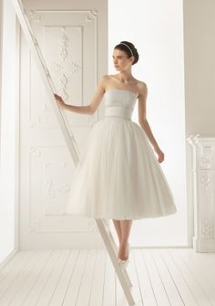 Ball Gown Strapless Tea-length in Tulle Wedding Dress.... This is cute simple and casual. Just what I've always wanted.