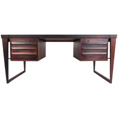 Mid-Century Modern Rosewood Executive Desk by Kai Kristiansen | From a unique collection of antique and modern desks and writing tables at https://www.1stdibs.com/furniture/tables/desks-writing-tables/