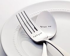 A cheeky his and hers set that reads spoon me and fork you!  ♥ Things to know:  Food safe!  Metal stamping is a slow and careful process done by hand, which means that there will be slight variations in letter depth and placement creating a truly one of a kind keepsake.  Silverware brand and handle design is subject to availability. All of the pieces that BVDH carries are new, modern and similar in style.
