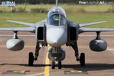 The Gripen looks good head-on as this Hungarian Air Force example, based at Kecskemet with the TFW, proves. It is seen taxying in after arriving at RAF Fairford for the 2014 Royal International Air Tattoo. Military Jets, Military Aircraft, Saab Jas 39 Gripen, New Jet, Fire Fighters, Jet Plane, Nose Art, War Machine, Airplanes