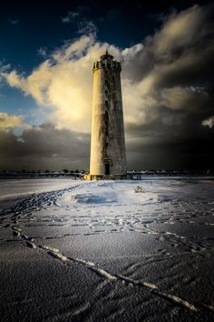 Grótta lighthouse - This shot was taken last winter in March 2014, when we had lots of snow here in Reykjavik. I went to Grótta and walked around the spit of land for an hour and got some great shots.  Grótta is a spit of land in Seltjarnarnes, a neighboring town of Reykjavík, which turns into an island at high tide. During low tide one can reach Grótta on foot and stay there for approximately six hours before the isthmus is flooded. The first lighthouse in Grótta was built in 1897 and the…