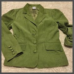"Old Navy ✨ Green Corduroy Blazer Old Navy green cord jacket. 3 green buttons line front. 2 front pockets, & green lining. So cute & great shape! Size Medium - Please see approximate measurements below.   22.5"" Length 37"" Bust when buttoned 24""' Sleeve length  Shell: 100% Cotton Fully lined with polyester Machine washable Pet free/smoke free - Clean Home! Next day shipper - See my Love Notes! ❤️   I consider offers through offer feature  Old Navy Jackets & Coats Blazers"