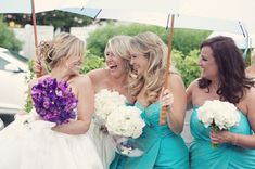 Aqua bridesmaids dresses and purple and white flowers, photo by reign7photo.com