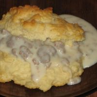 "Cat Head Biscuits And Sausage Gravy Recipe. My husband's Grandmother Owens always made cat head biscuits. This means they are ""large"" about as big as a cat's head. She used a drinking glass for her cutter. <3 nana gloria"