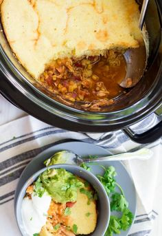 You're never going to believe it, but this entire chicken chili with cornbread topping cooks in your slow cooker.  So easy!!  And, wait until you see the other shortcuts in the ingredient list! #SlowCookerRecipes #ChickenChili